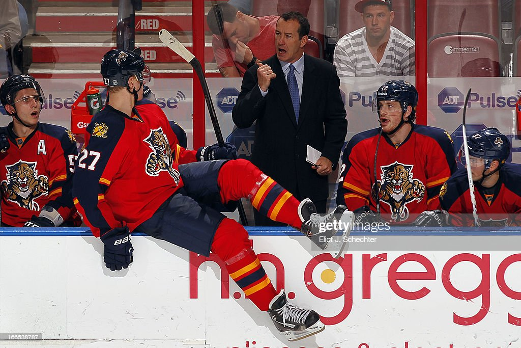 Head Coach <a gi-track='captionPersonalityLinkClicked' href=/galleries/search?phrase=Kevin+Dineen&family=editorial&specificpeople=654130 ng-click='$event.stopPropagation()'>Kevin Dineen</a> of the Florida Panthers sends Nick Bjugstad #27 back into the acrtion against the Pittsburgh Penguins at the BB&T Center on April 13, 2013 in Sunrise, Florida.