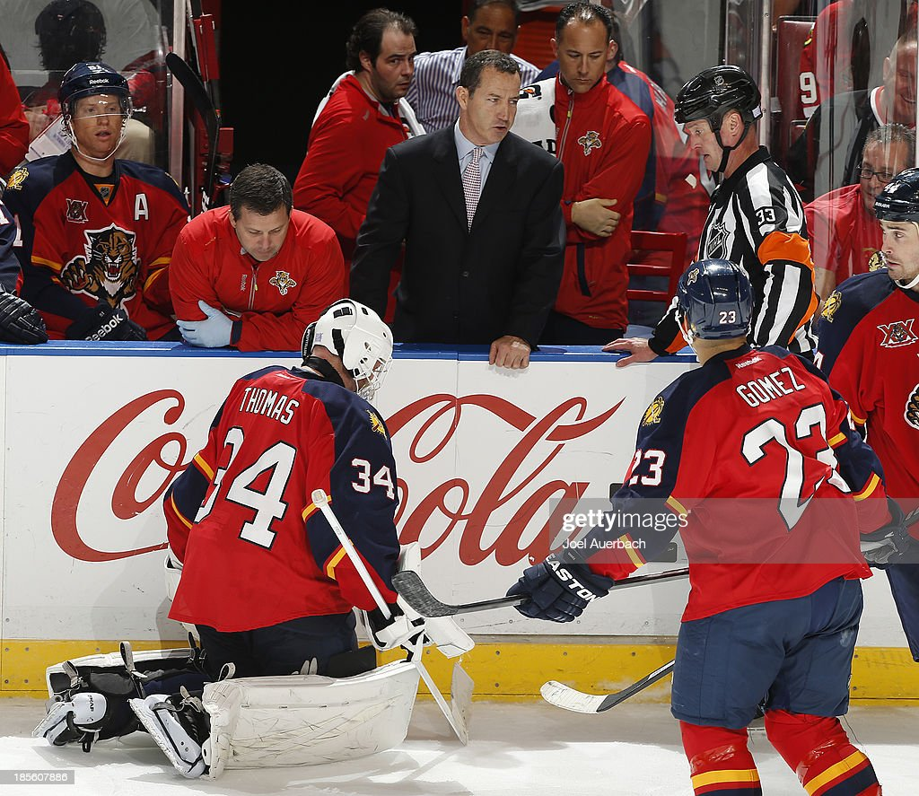 Head coach <a gi-track='captionPersonalityLinkClicked' href=/galleries/search?phrase=Kevin+Dineen&family=editorial&specificpeople=654130 ng-click='$event.stopPropagation()'>Kevin Dineen</a> of the Florida Panthers talks to Referee Kevin Pollock #33 in regard to the injury of goaltender Tim Thomas #34 during third period action against the Chicago Blackhawks at the BB&T Center on October 22, 2013 in Sunrise, Florida. The Blackhawks defeated the Panthers 3-2 in a shoot-out.