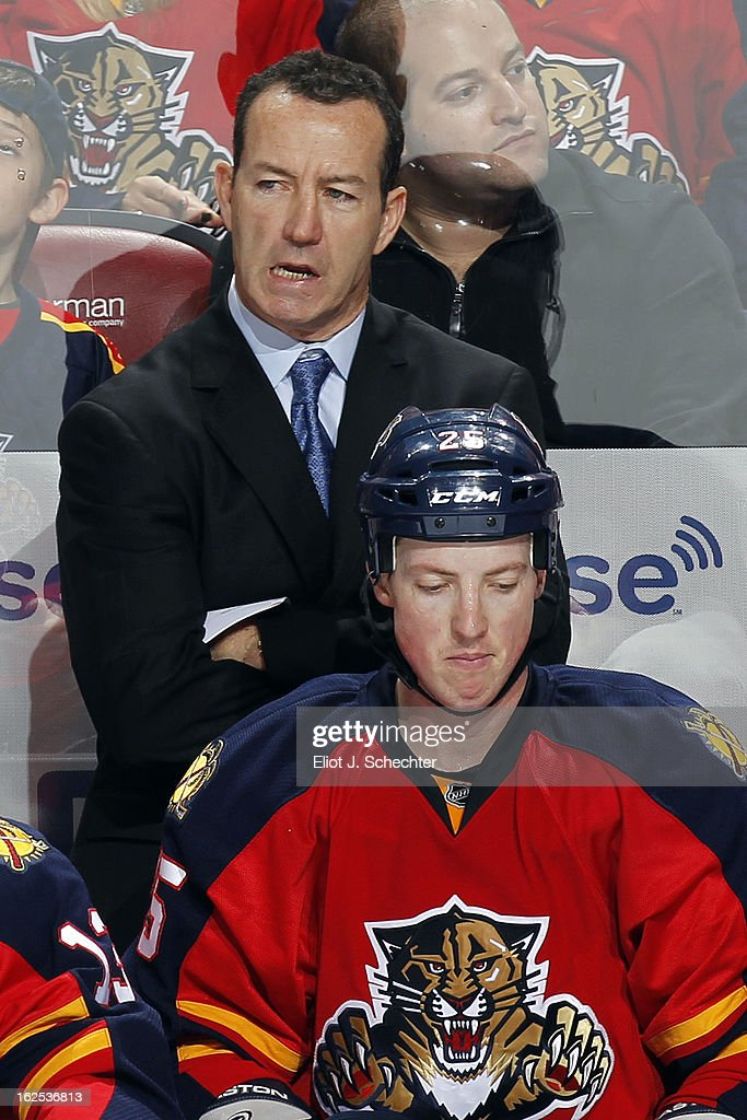 Head Coach <a gi-track='captionPersonalityLinkClicked' href=/galleries/search?phrase=Kevin+Dineen&family=editorial&specificpeople=654130 ng-click='$event.stopPropagation()'>Kevin Dineen</a> of the Florida Panthers watches the action against the Boston Bruins at the BB&T Center on February 24, 2013 in Sunrise, Florida.