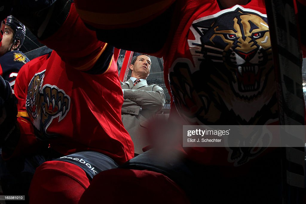 Head Coach Kevin Dineen of the Florida Panthers watches the action from the bench against the Winnipeg Jets at the BB&T Center on March 8, 2013 in Sunrise, Florida.