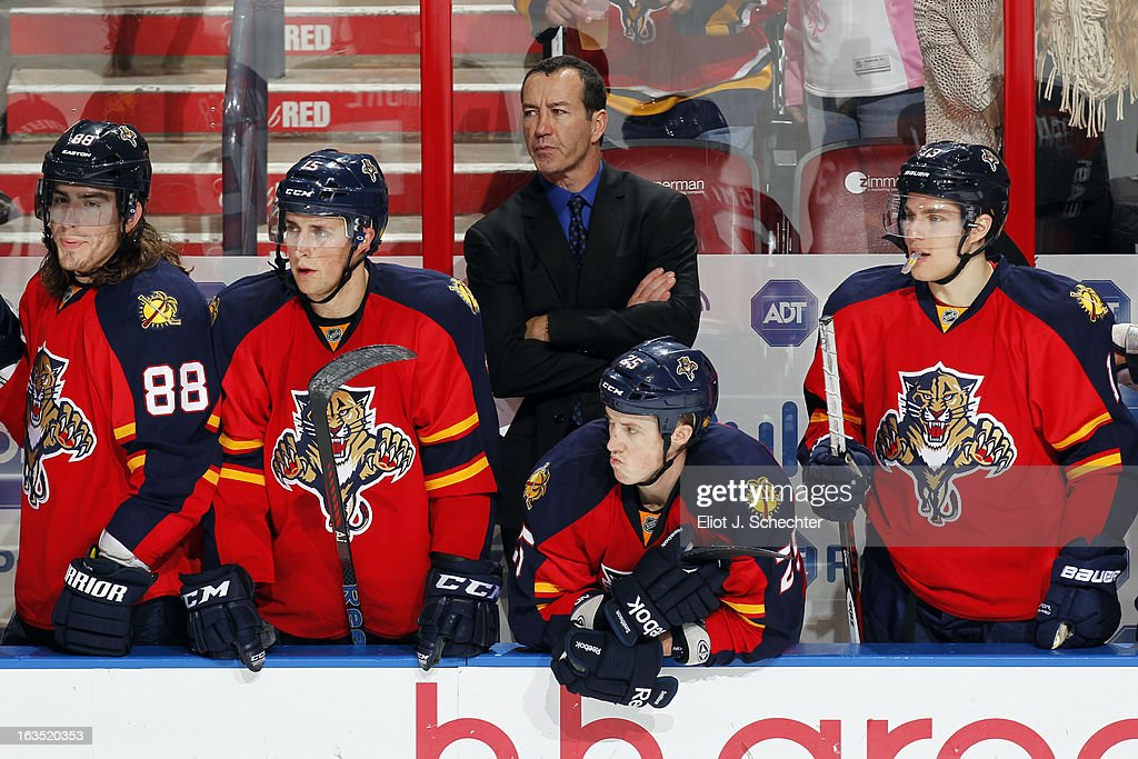 Head Coach Kevin Dineen of the Florida Panthers watches the action with his team against the Montreal Canadiens at the BB&T Center on March 10, 2013 in Sunrise, Florida.