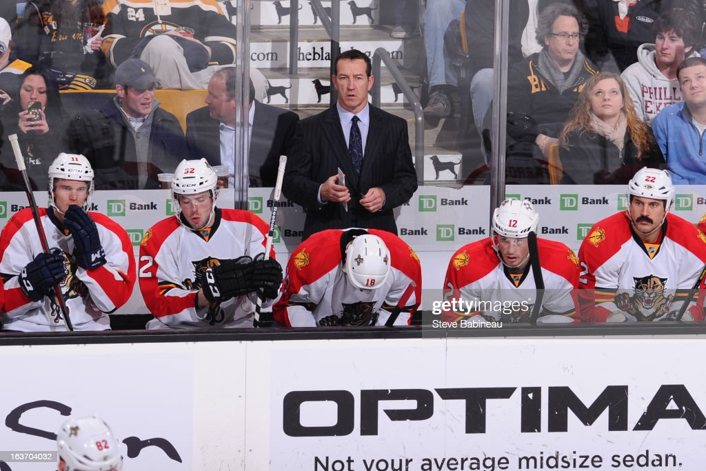 Head coach <a gi-track='captionPersonalityLinkClicked' href=/galleries/search?phrase=Kevin+Dineen&family=editorial&specificpeople=654130 ng-click='$event.stopPropagation()'>Kevin Dineen</a> of the Florida Panthers watches the play against the Boston Bruins at the TD Garden on March 14, 2013 in Boston, Massachusetts.