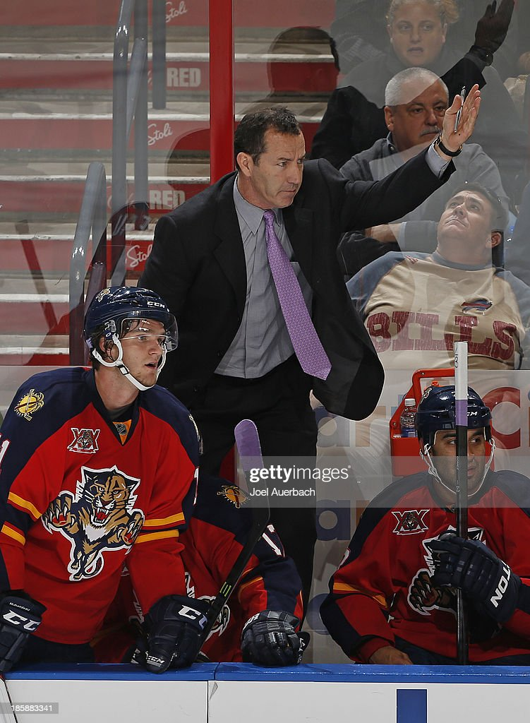 Head coach Kevin Dineen signals goaltender Jacob Markstrom #25 (not pictured) of the Florida Panthers to come out of the net late in the third period against the Buffalo Sabres at the BB&T Center on October 25, 2013 in Sunrise, Florida. The Sabres defeated the Panthers 3-1.