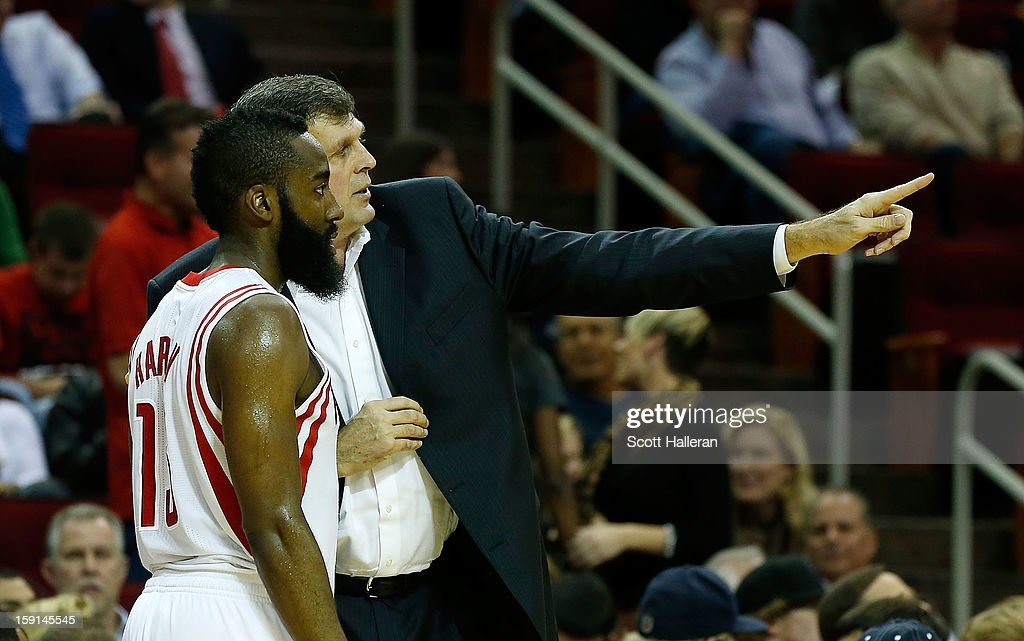 Head coach Kevin McHale of the Houston Rockets chats with James Harden #13 during the game against the Los Angeles Lakers at Toyota Center on January 8, 2013 in Houston, Texas.