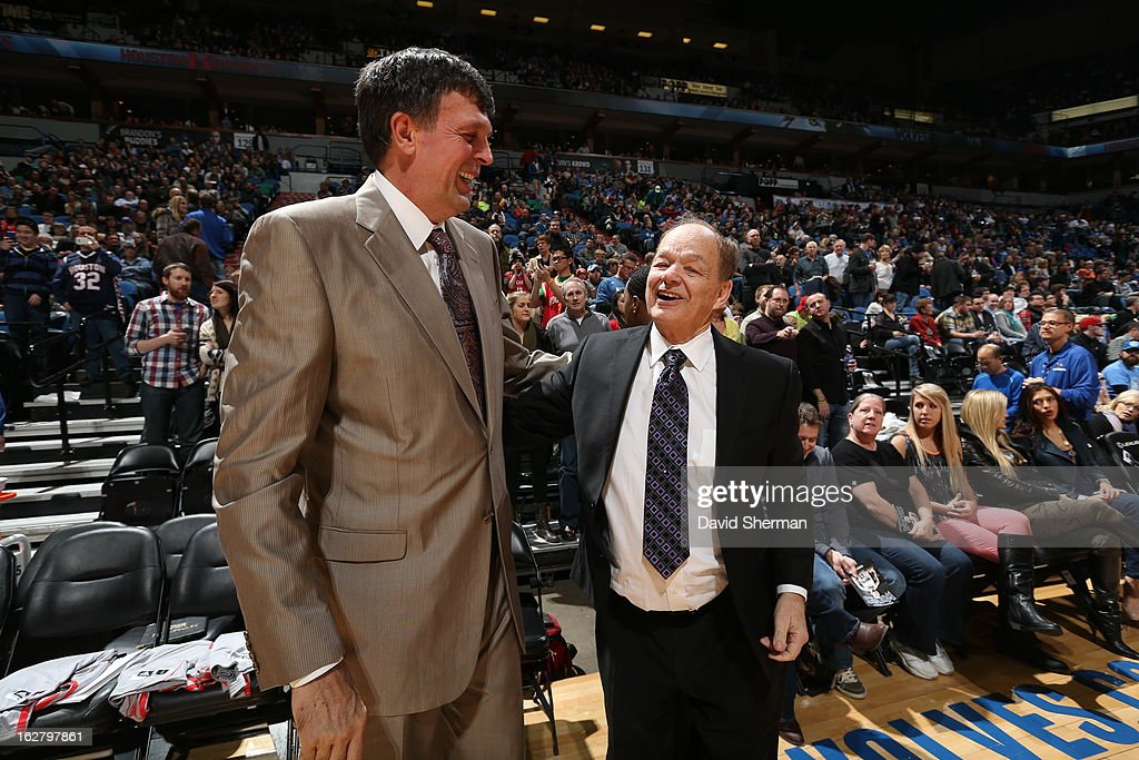 Head Coach Kevin McHale of the Houston Rockets, left, speaks with Glen Taylor, owner of the Minnesota Timberwolves, before the teams played a game on December 26, 2012 at Target Center in Minneapolis, Minnesota.