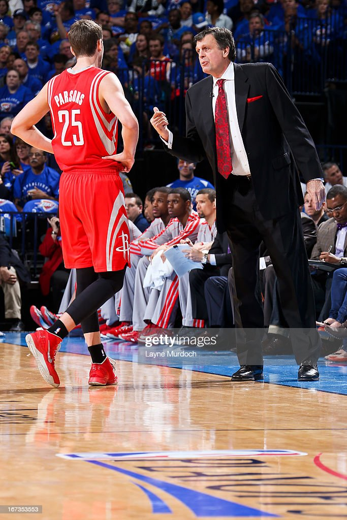 Head Coach Kevin McHale of the Houston Rockets speaks with Chandler Parsons #25 while playing against the Oklahoma City Thunder in Game Two of the Western Conference Quarterfinals during the 2013 NBA Playoffs on April 24, 2013 at the Chesapeake Energy Arena in Oklahoma City, Oklahoma.