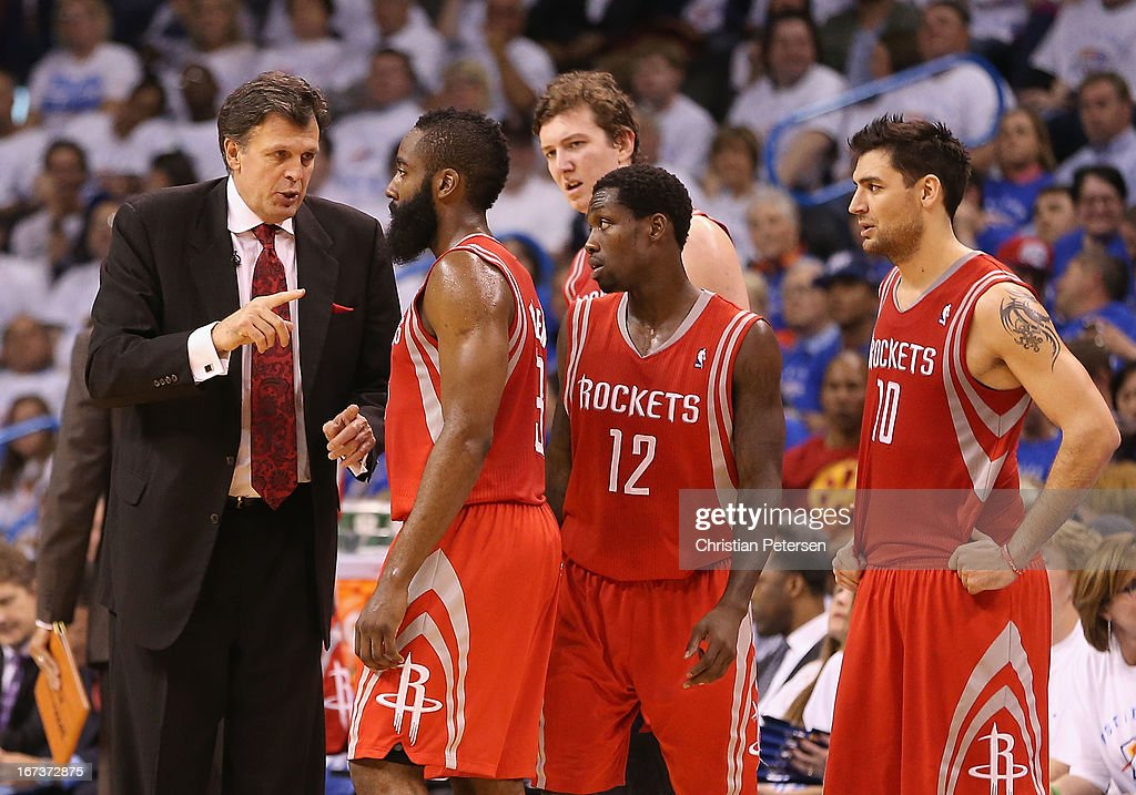 Head coach Kevin McHale of the Houston Rockets talks with James Harden #13, Patrick Beverley #12, Omer Asik #3 and Carlos Delfino #10 during a break from Game Two of the Western Conference Quarterfinals of the 2013 NBA Playoffs against the Oklahoma City Thunder at Chesapeake Energy Arena on April 24, 2013 in Oklahoma City, Oklahoma. The Thunder defeated the Rockets 105-102.