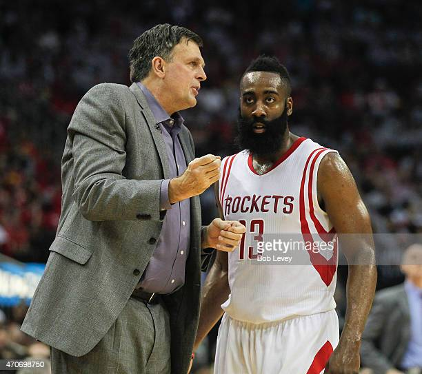 Head coach Kevin McHale of the Houston Rockets talks with James Harden during Game Two of the Western Conference Quarterfinals of the 2015 NBA...