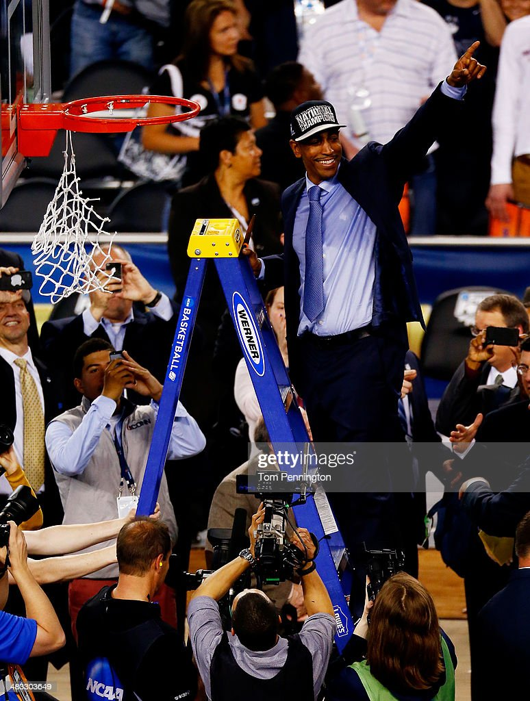 Head coach <a gi-track='captionPersonalityLinkClicked' href=/galleries/search?phrase=Kevin+Ollie&family=editorial&specificpeople=202896 ng-click='$event.stopPropagation()'>Kevin Ollie</a> of the Connecticut Huskies acknowledges the crowd after defeating the Kentucky Wildcats 60-54 in the NCAA Men's Final Four Championship at AT&T Stadium on April 7, 2014 in Arlington, Texas.