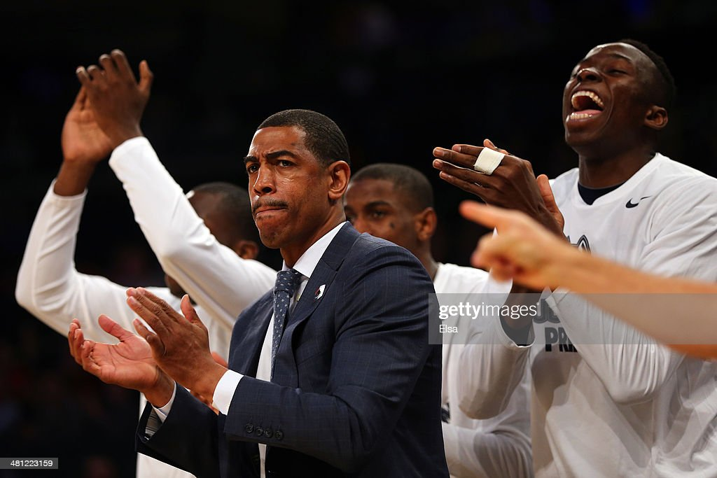 Head coach <a gi-track='captionPersonalityLinkClicked' href=/galleries/search?phrase=Kevin+Ollie&family=editorial&specificpeople=202896 ng-click='$event.stopPropagation()'>Kevin Ollie</a> of the Connecticut Huskies claps as his team celebrates behind him as they take on the Iowa State Cyclones during the regional semifinal of the 2014 NCAA Men's Basketball Tournament at Madison Square Garden on March 28, 2014 in New York City.