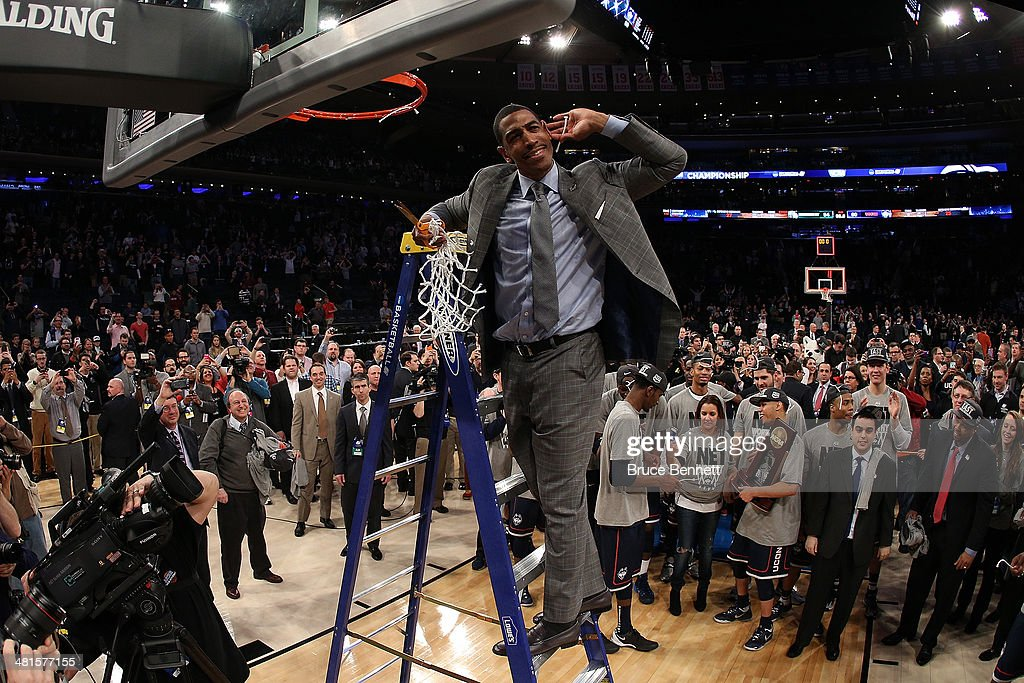 Head coach <a gi-track='captionPersonalityLinkClicked' href=/galleries/search?phrase=Kevin+Ollie&family=editorial&specificpeople=202896 ng-click='$event.stopPropagation()'>Kevin Ollie</a> of the Connecticut Huskies cuts down the net after defeating the Michigan State Spartans to win the East Regional Final of the 2014 NCAA Men's Basketball Tournament at Madison Square Garden on March 30, 2014 in New York City.