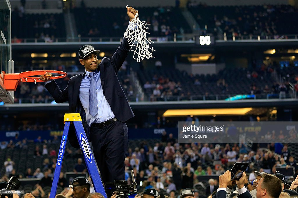 Head coach <a gi-track='captionPersonalityLinkClicked' href=/galleries/search?phrase=Kevin+Ollie&family=editorial&specificpeople=202896 ng-click='$event.stopPropagation()'>Kevin Ollie</a> of the Connecticut Huskies cuts down the net after defeating the Kentucky Wildcats 60-54 in the NCAA Men's Final Four Championship at AT&T Stadium on April 7, 2014 in Arlington, Texas.