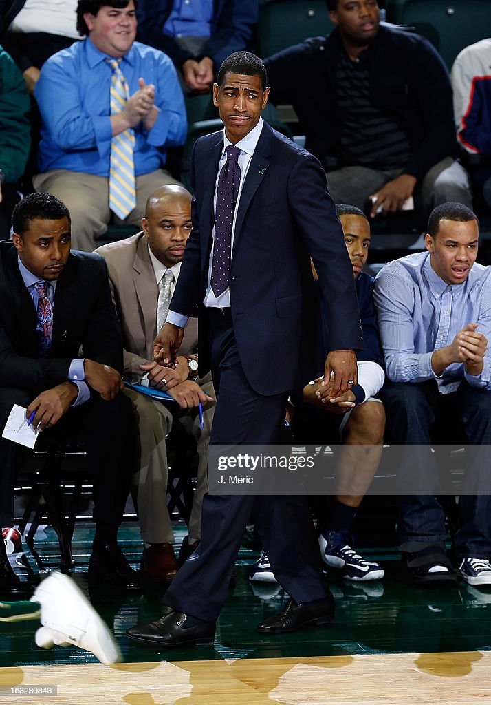 Head coach <a gi-track='captionPersonalityLinkClicked' href=/galleries/search?phrase=Kevin+Ollie&family=editorial&specificpeople=202896 ng-click='$event.stopPropagation()'>Kevin Ollie</a> of the Connecticut Huskies directs his team against the South Florida Bulls during the game at the Sun Dome on March 6, 2013 in Tampa, Florida.