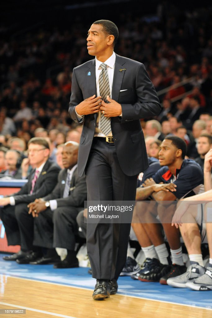 Head coach Kevin Ollie of the Connecticut Huskies looks on during the Jimmy V Classic college basketball game against the North Carolina State Wolfpack on December 4, 2012 at Madison Square Garden in New York, New York. The Wolfpack won 69-65.