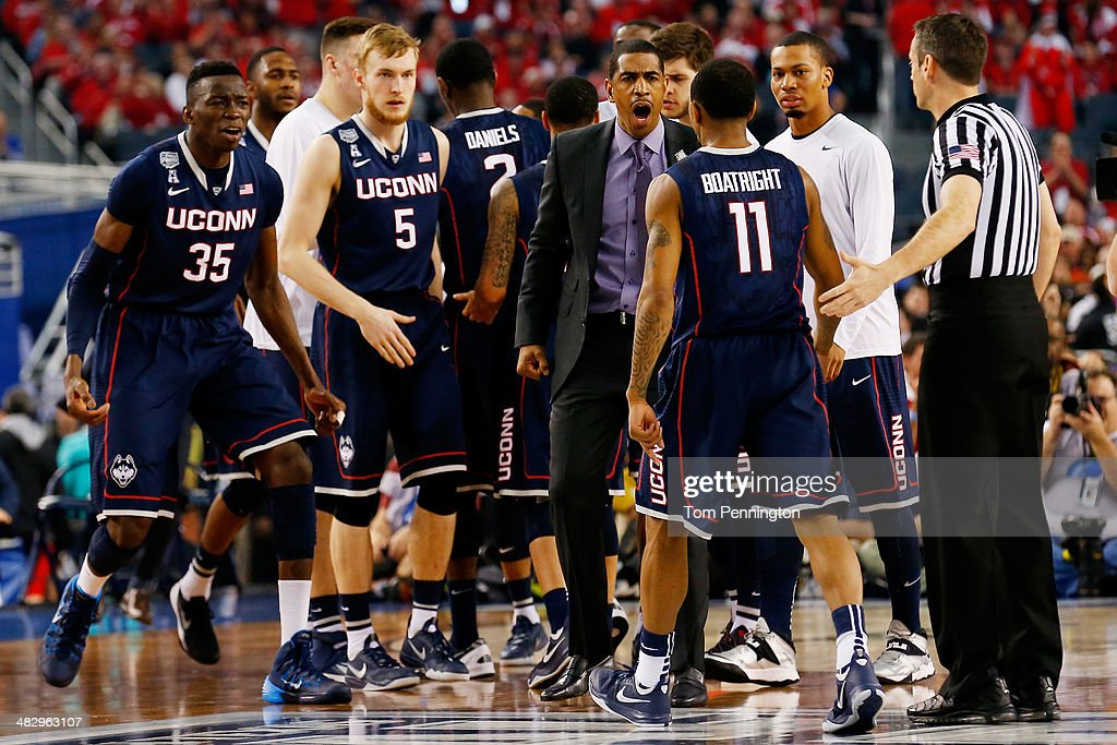 Head coach <a gi-track='captionPersonalityLinkClicked' href=/galleries/search?phrase=Kevin+Ollie&family=editorial&specificpeople=202896 ng-click='$event.stopPropagation()'>Kevin Ollie</a> of the Connecticut Huskies reacts after calling a timeout during the NCAA Men's Final Four Semifinal against the Florida Gators at AT&T Stadium on April 5, 2014 in Arlington, Texas.