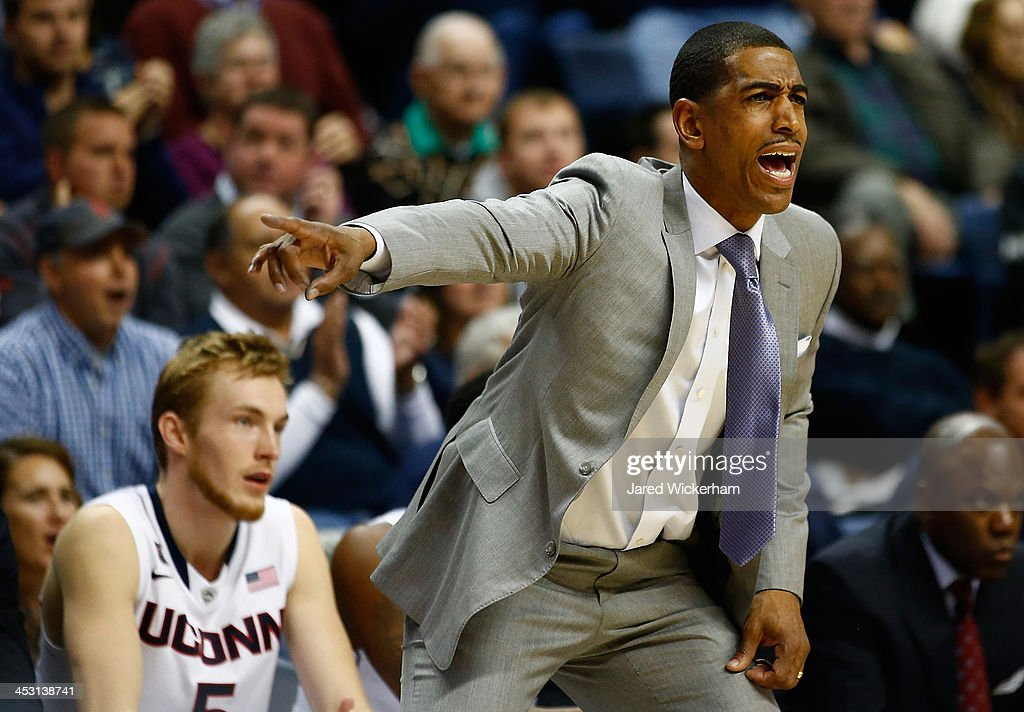 Head coach Kevin Ollie of the Connecticut Huskies yells to his team in the first half against the Florida Gators during the game at Harry A. Gampel Pavilion on December 2, 2013 in Storrs, Connecticut.