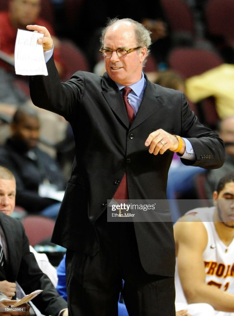 Head coach <a gi-track='captionPersonalityLinkClicked' href=/galleries/search?phrase=Kevin+O%27Neill&family=editorial&specificpeople=240230 ng-click='$event.stopPropagation()'>Kevin O'Neill</a> of the USC Trojans gestures to his players as they take on the UNLV Rebels during the third round of the Continental Tire Las Vegas Invitational at the Orleans Arena November 25, 2011 in Las Vegas, Nevada. UNLV won 66-55.