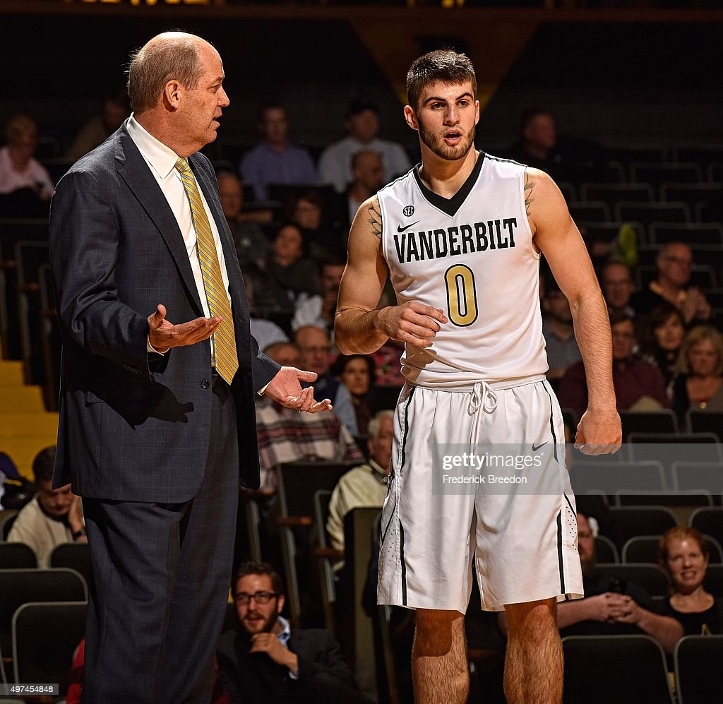 Head coach <a gi-track='captionPersonalityLinkClicked' href=/galleries/search?phrase=Kevin+Stallings&family=editorial&specificpeople=712268 ng-click='$event.stopPropagation()'>Kevin Stallings</a> of the Vanderbilt Commodores coaches Camron Justice #0 during the second half of a game against Gardner-Webb at Memorial Gym on November 16, 2015 in Nashville, Tennessee.