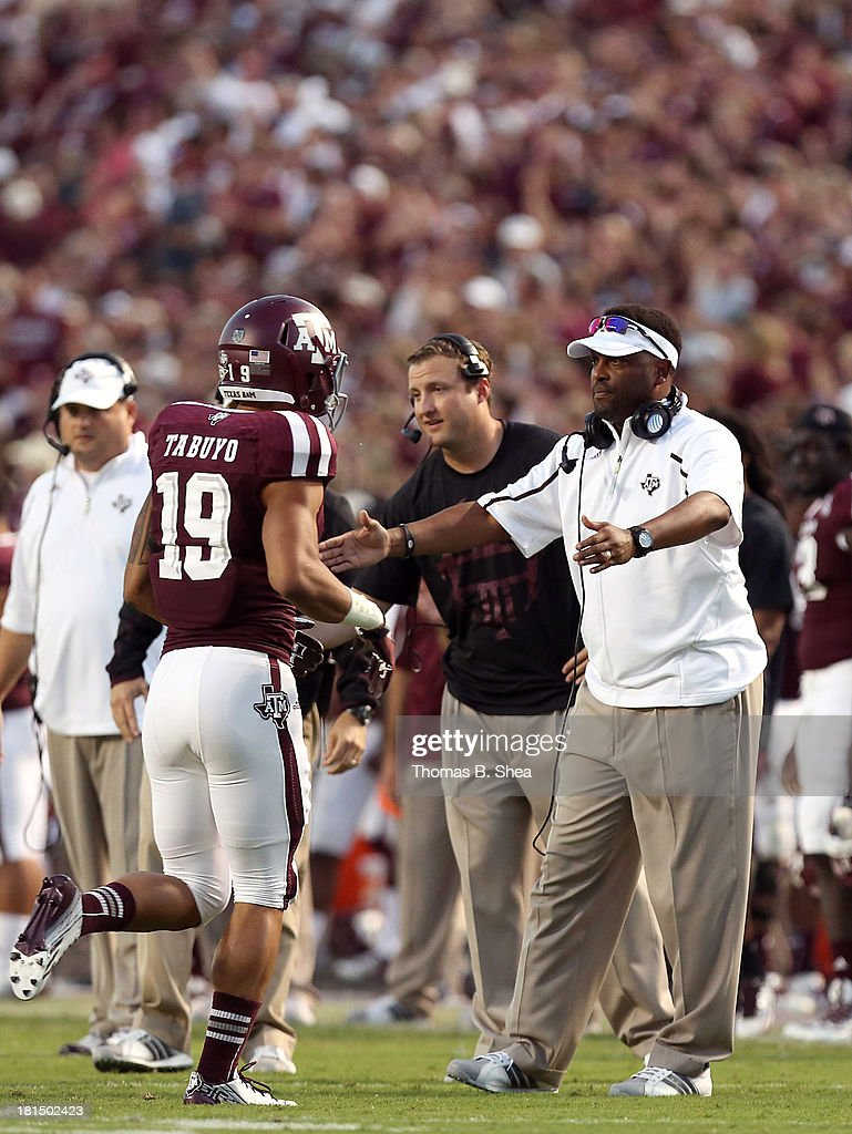 Head coach Kevin Sumlin congratulates his team after scoring against Southern Methodist Mustangs of the Texas A&M Aggies in the second half on September 21, 2013 at Kyle Field in College Station, Texas.