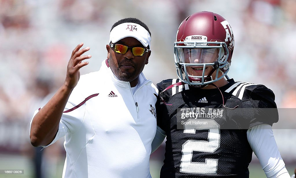 Head coach Kevin Sumlin of the Texas A&M Aggies chats with his quarterback Johnny Manziel #2 before the Maroon & White spring football game at Kyle Field on April 13, 2013 in College Station, Texas.