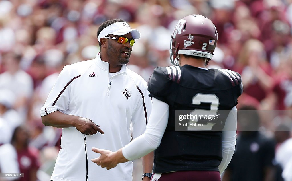 Head coach Kevin Sumlin of the Texas A&M Aggies chats with his quarterback Johnny Manziel #2 during the Maroon & White spring football game at Kyle Field on April 13, 2013 in College Station, Texas.