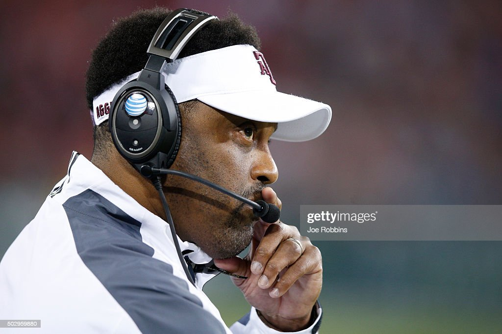 Head coach <a gi-track='captionPersonalityLinkClicked' href=/galleries/search?phrase=Kevin+Sumlin&family=editorial&specificpeople=4819265 ng-click='$event.stopPropagation()'>Kevin Sumlin</a> of the Texas A&M Aggies looks on against the Louisville Cardinals in the first half of the Franklin American Mortgage Music City Bowl at Nissan Stadium on December 30, 2015 in Nashville, Tennessee.