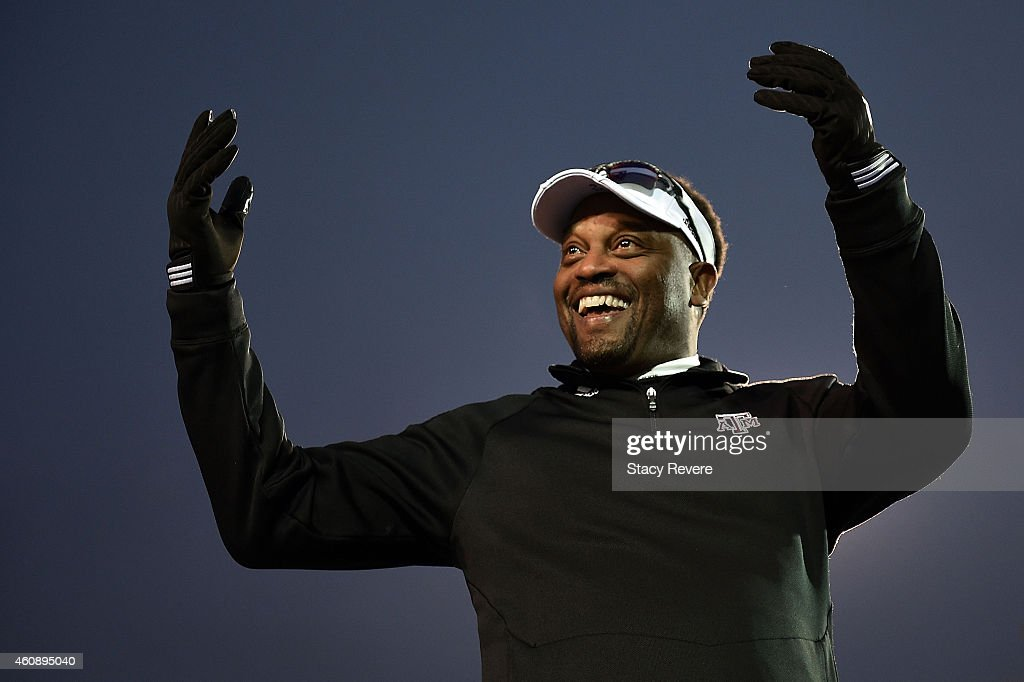 Head coach <a gi-track='captionPersonalityLinkClicked' href=/galleries/search?phrase=Kevin+Sumlin&family=editorial&specificpeople=4819265 ng-click='$event.stopPropagation()'>Kevin Sumlin</a> of the Texas A&M Aggies looks to the crowd following a victory over the West Virginia Mountaineers in the 56th annual Autozone Liberty Bowl at Liberty Bowl Memorial Stadium on December 29, 2014 in Memphis, Tennessee.