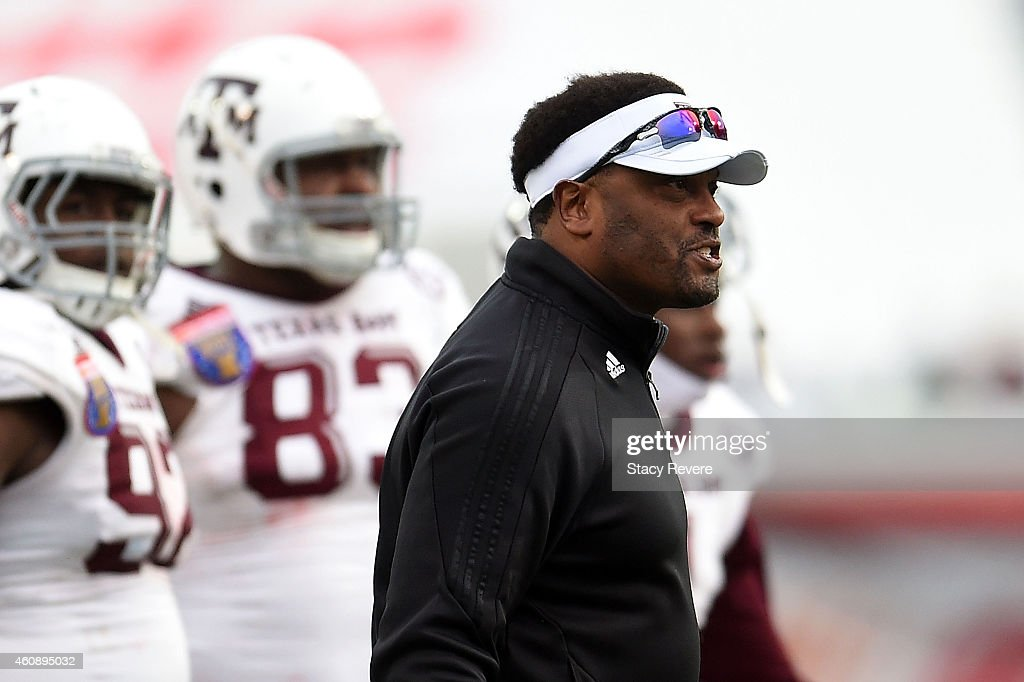 Head coach <a gi-track='captionPersonalityLinkClicked' href=/galleries/search?phrase=Kevin+Sumlin&family=editorial&specificpeople=4819265 ng-click='$event.stopPropagation()'>Kevin Sumlin</a> of the Texas A&M Aggies reacts to an official's call during the third quarter of the 56th annual Autozone Liberty Bowl against the West Virginia Mountaineers at Liberty Bowl Memorial Stadium on December 29, 2014 in Memphis, Tennessee.