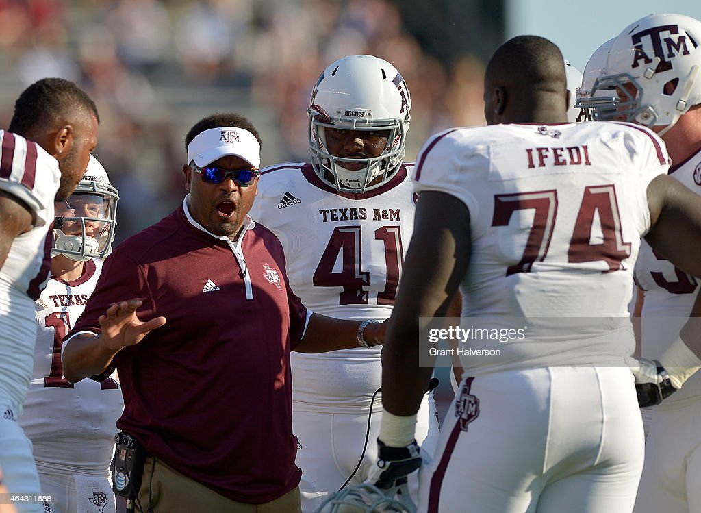 Head coach Kevin Sumlin of the Texas A&M Aggies talks with his players during their game against the South Carolina Gamecocks at Williams-Brice Stadium on August 28, 2014 in Columbia, South Carolina.
