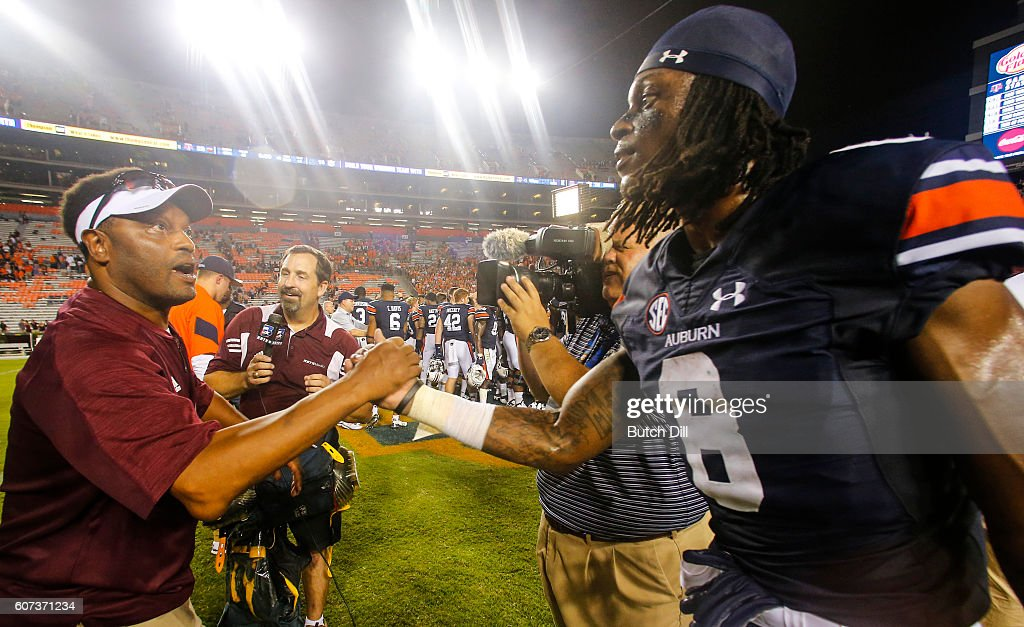 Head Coach Kevin Sumlin of the Texas A&M Aggies talks with wide receiver Tony Stevens #8 of the Auburn Tigers after the second half of an NCAA college football game on September 17, 2016 in Auburn, Alabama. Texas A&M Aggies won 29-16