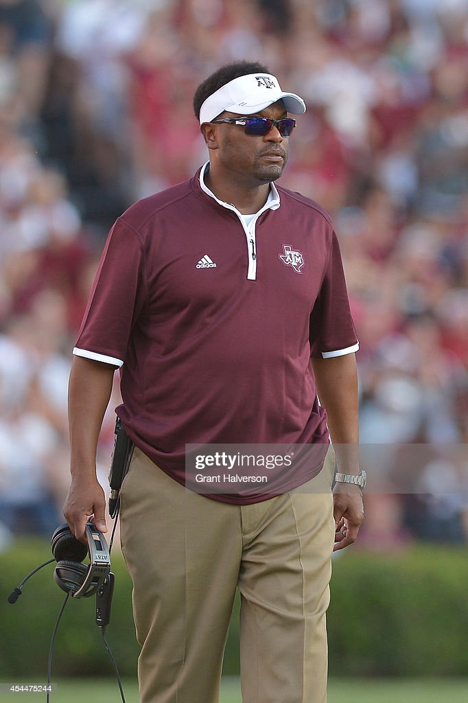 Head coach <a gi-track='captionPersonalityLinkClicked' href=/galleries/search?phrase=Kevin+Sumlin&family=editorial&specificpeople=4819265 ng-click='$event.stopPropagation()'>Kevin Sumlin</a> of the Texas A&M Aggies watches his team play against the South Carolina Gamecocks during their game at Williams-Brice Stadium on August 28, 2014 in Columbia, South Carolina.