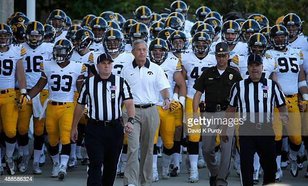 Head coach Kirk Ferentz of the Iowa Hawkeyes and his football team take the field at Jack Trice Stadium on September 12 2015 in Ames Iowa The Iowa...