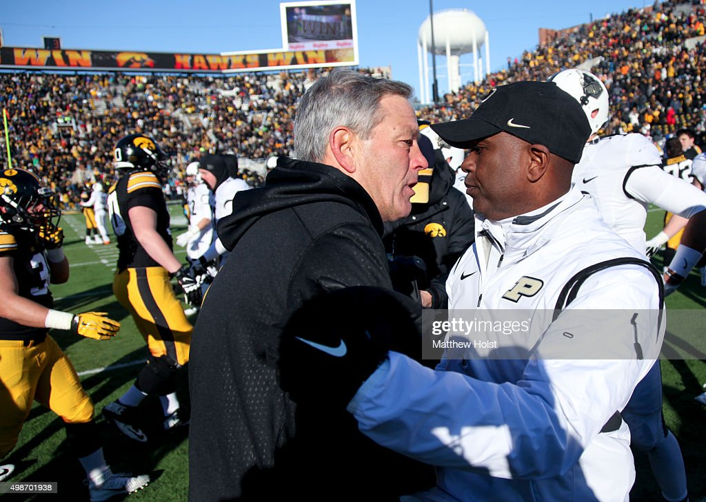 Head coach <a gi-track='captionPersonalityLinkClicked' href=/galleries/search?phrase=Kirk+Ferentz&family=editorial&specificpeople=2108097 ng-click='$event.stopPropagation()'>Kirk Ferentz</a> of the Iowa Hawkeyes meets with head coach <a gi-track='captionPersonalityLinkClicked' href=/galleries/search?phrase=Darrell+Hazell&family=editorial&specificpeople=7730325 ng-click='$event.stopPropagation()'>Darrell Hazell</a> of the Purdue Boilermakers following their match-up on November 21, 2015 at Kinnick Stadium, in Iowa City, Iowa.