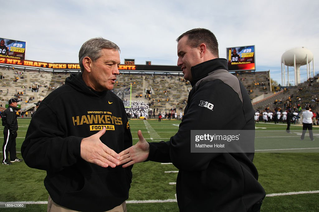 Head coach Kirk Ferentz of the Iowa Hawkeyes shakes hands with head coach Pat Fitzgerald of the Northwestern Wildcats prior to their match-up on October 26, 2013 at Kinnick Stadium in Iowa City, Iowa.