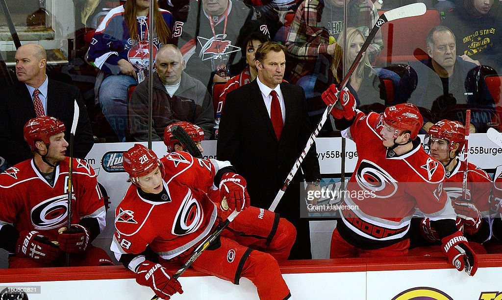 Head coach Kirk Mueller of the Carolina Hurricanes watches his team during a line change agaist the Ottowa Senators during play at PNC Arena on February 1, 2013 in Raleigh, North Carolina. The Hurricanes defeated the Senators 1-0.