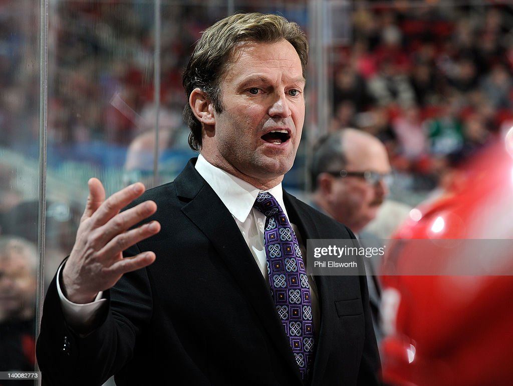 Head coach Kirk Muller of the Carolina Hurricanes addresses his players during an NHL game against the Anaheim Ducks on February 23, 2012 at RBC Center in Raleigh, North Carolina.