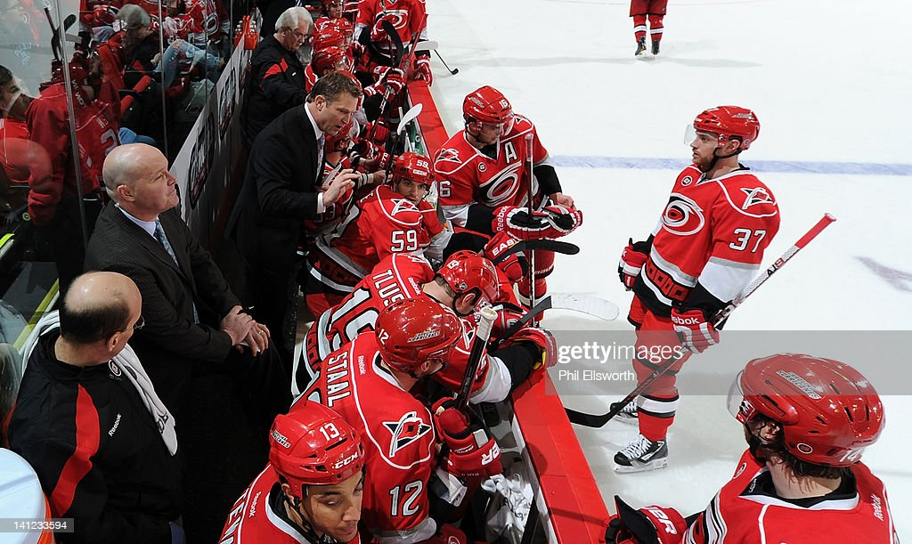 Head coach Kirk Muller of the Carolina Hurricanes addresses his team during an NHL game against the Tampa Bay Lightning on March 3, 2012 at RBC Center in Raleigh, North Carolina.