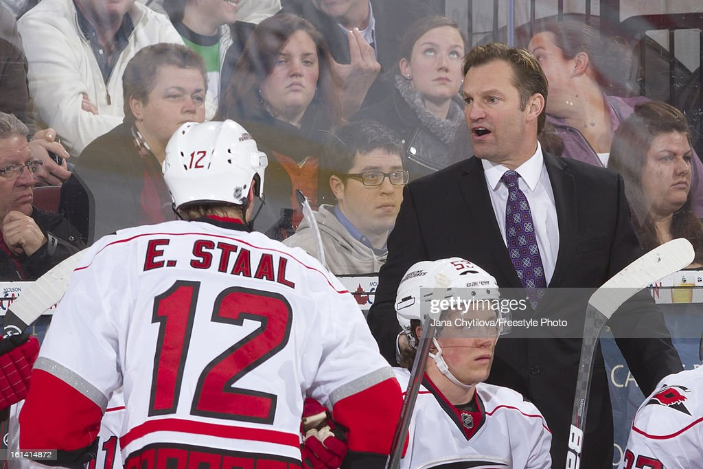 Head coach Kirk Muller of the Carolina Hurricanes gives instructions on the bench during an NHL game against the Ottawa Senators at Scotiabank Place on February 7, 2013 in Ottawa, Ontario, Canada.