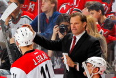 Head coach Kirk Muller of the Carolina Hurricanes gives instructions against the New Jersey Devils during the game at the Prudential Center on March...