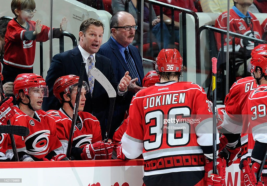 Head coach Kirk Muller of the Carolina Hurricanes speaks to the team during an NHL game against the St. Louis Blues on March 15, 2012 at PNC Arena in Raleigh, North Carolina.