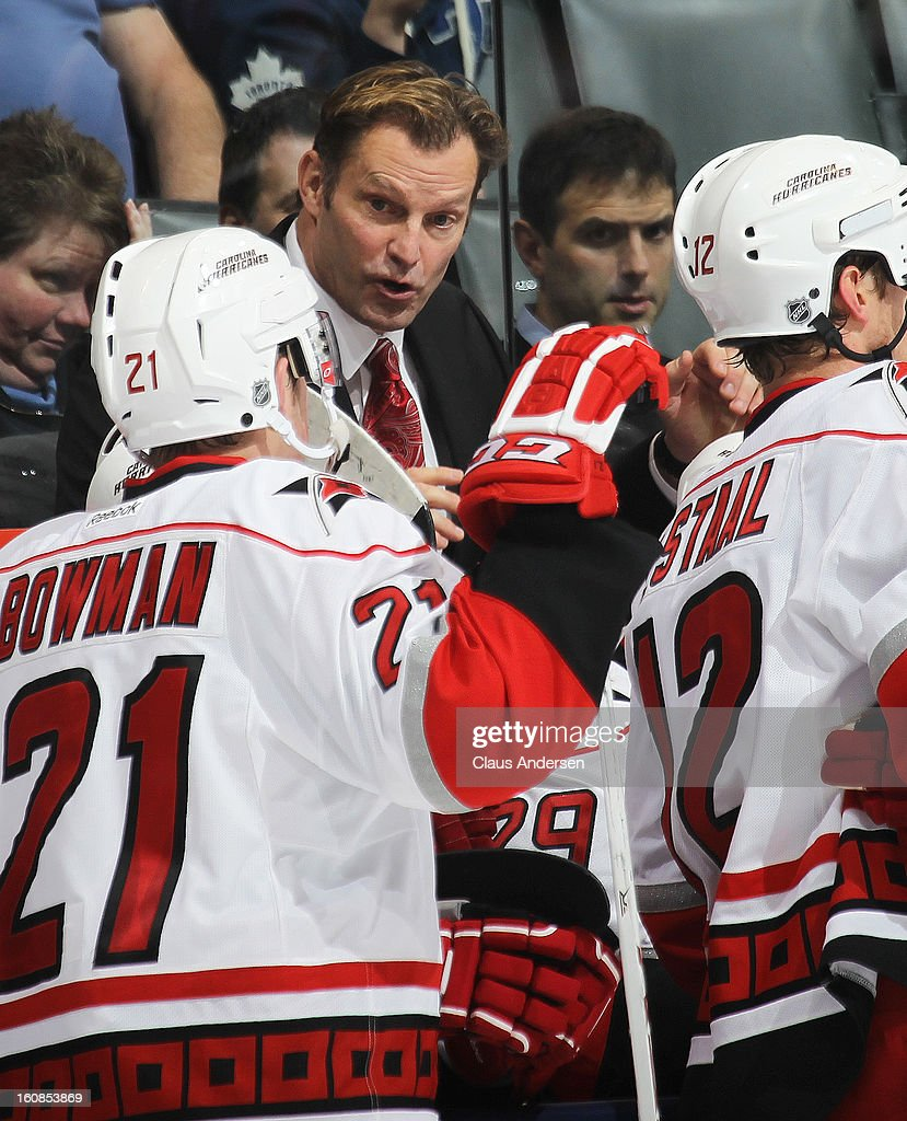 Head coach Kirk Muller of the Carolina Hurricanes talks to his players in a game against the Toronto Maple Leafs on February 4, 2013 at the Air Canada Centre in Toronto, Canada. The Hurricanes defeated the Leafs 4-1.