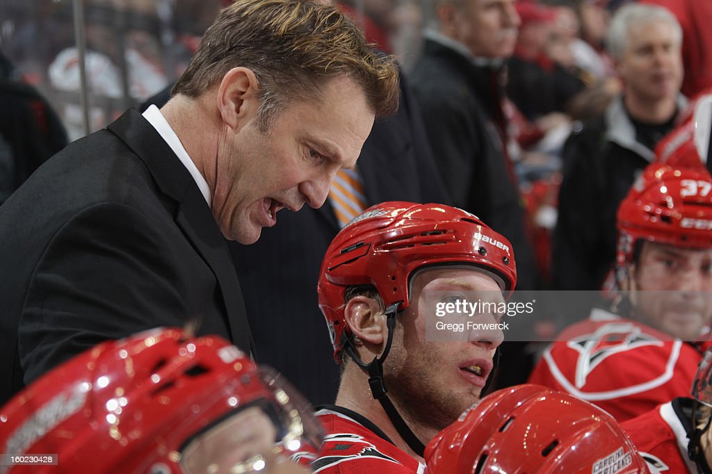 Head coach Kirk Muller of the Carolina Hurricanes talks with Hurricanes player Jordan Staal #11 during their NHL game against the Buffalo Sabres at PNC Arena on January 24, 2013 in Raleigh, North Carolina.