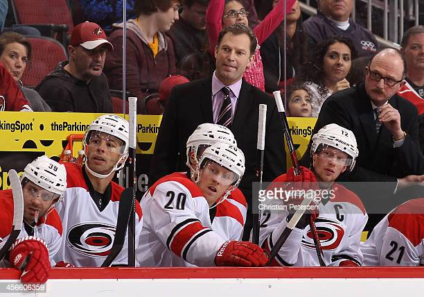 Head coach Kirk Muller of the Carolina Hurricanes watches from the bench during the NHL game against the Phoenix Coyotes at Jobingcom Arena on...