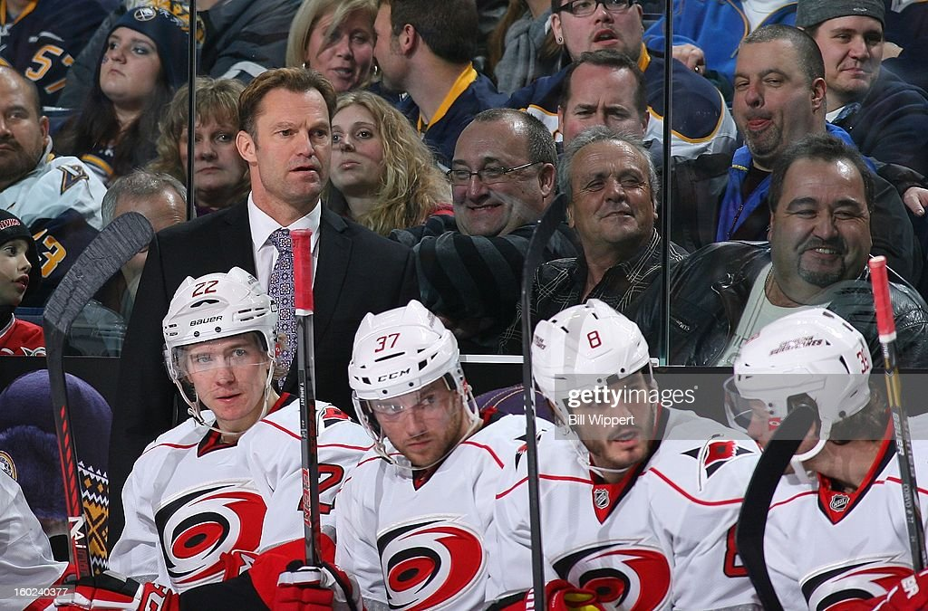 Head coach Kirk Muller of the Carolina Hurricanes watches their game against the Buffalo Sabres on January 25, 2013 at the First Niagara Center in Buffalo, New York.
