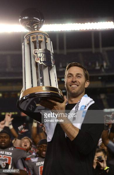 Head Coach Kliff Kingsbury of the Texas Tech Red Raiders hoists the Holiday Bowl Trophy after his teams' 3723 win over the Arizona State Sun Devils...