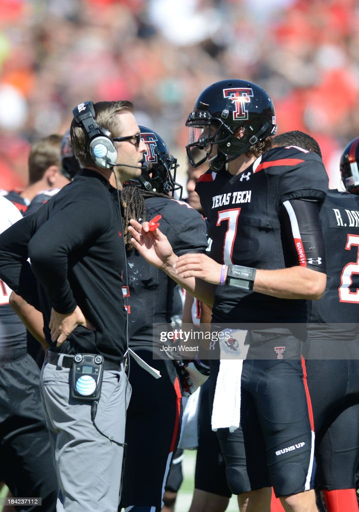 Head coach Kliff Kingsbury of the Texas Tech Red Raiders talks things over with quarterback Davis Webb #7 during game action against the Iowa State Cyclones on October 12, 2013 at AT&T Jones Stadium in Lubbock, Texas. Texas Tech won the game over Iowa State 42-35.
