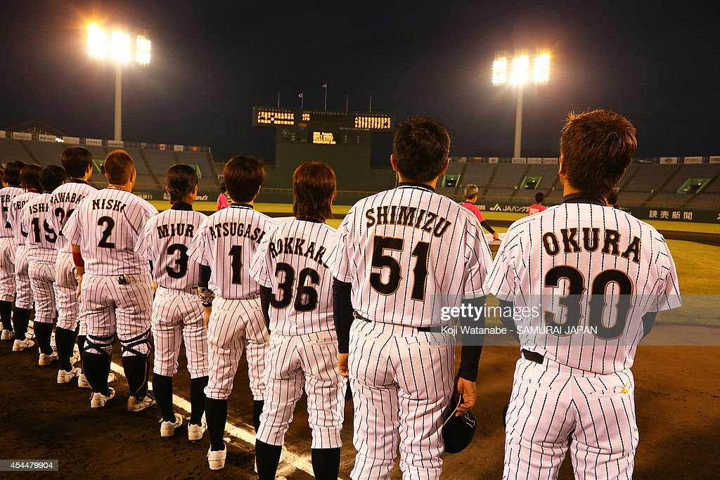 Head Coach Koichi Okura #30 and Japan team line up for national anthem during the IBAF Women's Baseball World Cup Group A game between Japan and Australia at Sun Marine Stadium on September 1, 2014 in Miyazaki, Japan.