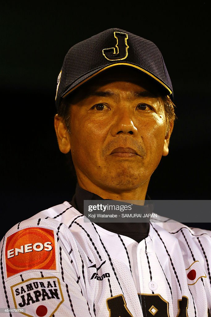 Head Coach <a gi-track='captionPersonalityLinkClicked' href=/galleries/search?phrase=Koichi+Okura&family=editorial&specificpeople=13537218 ng-click='$event.stopPropagation()'>Koichi Okura</a> #30 of Japan looks on the IBAF Women's Baseball World Cup Group A game between Japan and Australia at Sun Marine Stadium on September 1, 2014 in Miyazaki, Japan.