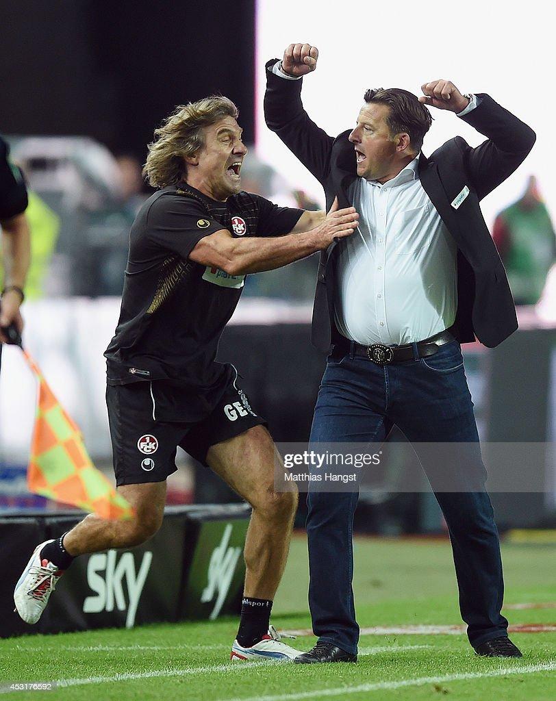 Head coach Kosta Runjaic of Kaiserslautern and goalkeeper coach Gerald Ehrmann celebrate after the final whistle during the Second Bundesliga match...