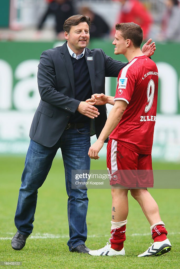 Head coach Kosta Runjaic of Kaiserslautern comforts Simon Zoller of Kaiserslautern after the the Second Bundesliga match between 1. FC Kaiserslautern and Karlsruher SC at Fritz-Walter-Stadion on October 20, 2013 in Kaiserslautern, Germany. The match between Kaiserslautern and Karlsruhe ended 2-2.